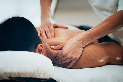 Sports Massage. Therapist Massaging Shoulders